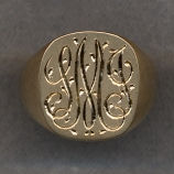 A Gold Monogram Ring.