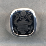 A man's stone ring with the Great Seal of the United States.