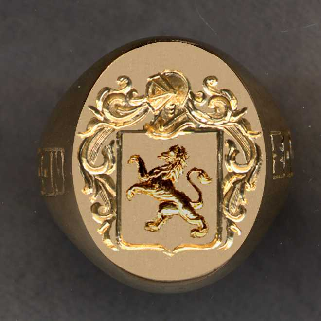 Ring after we removed a broken stone and substituted a plate of 14k gold where we have engraved a family crest