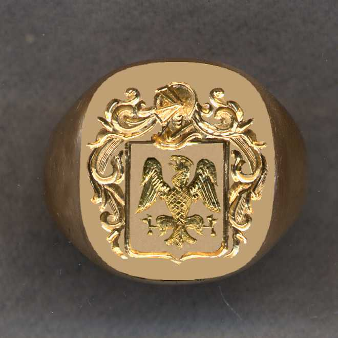 This was an old solid gold ring with initials etched on the surface. We have removed initials and engraved the family crest on the resulting surface.